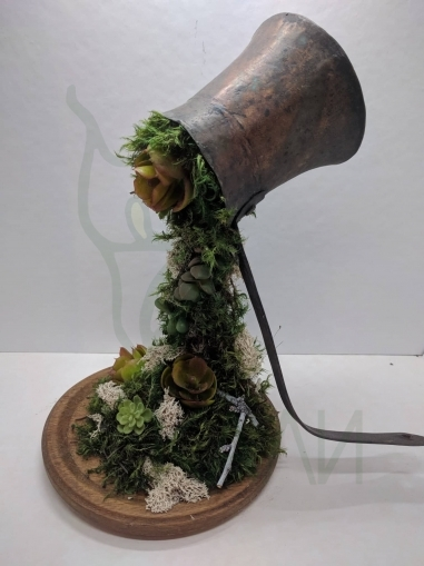 Handmade waterfall from preserved moss and succulents