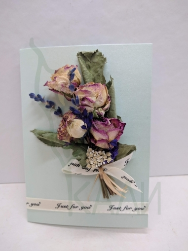 Handmade gift card with preserved flowers and herbs